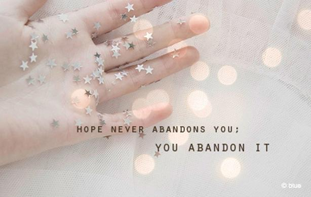 Hope never abandons you, you abandon it Picture Quote #1