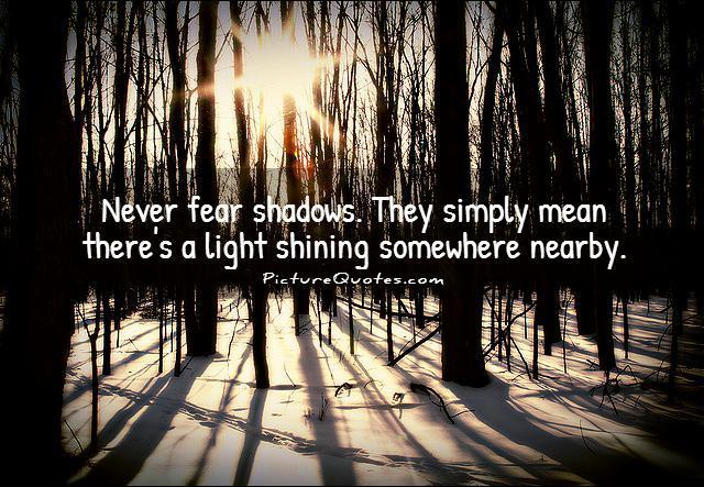 Never fear shadows. They simply mean there's a light shining somewhere nearby Picture Quote #1