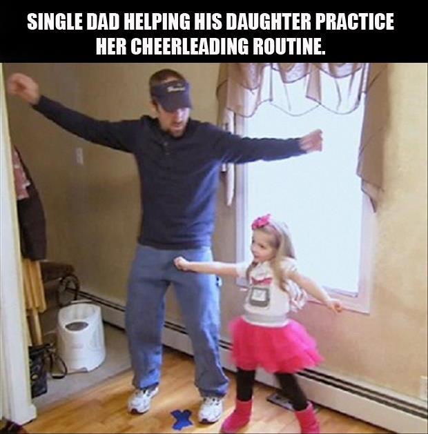 Single dad helping his daughter practice her cheerleading ...