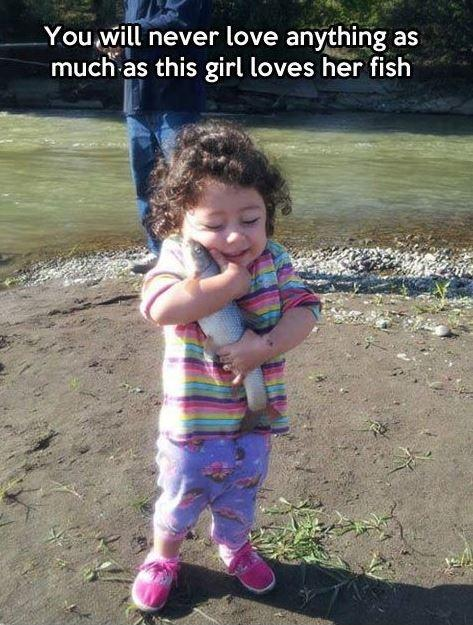 You will never love anything as much as this girl loves her fish Picture Quote #1
